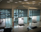 Executive Screens by Phantom at a car dealership. Solar screens keep out overpowering sunlight.
